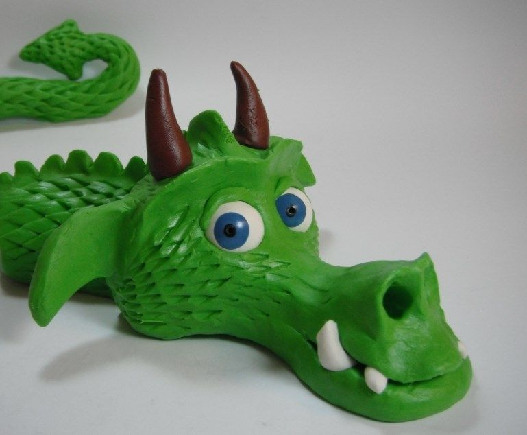 Dragon head made from plasticine with Sculpey eyes.